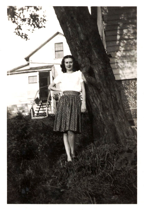 Helen standing by a tree
