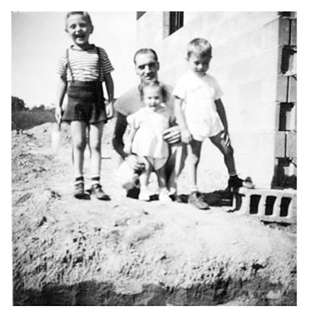 Freer with children back of house 1947