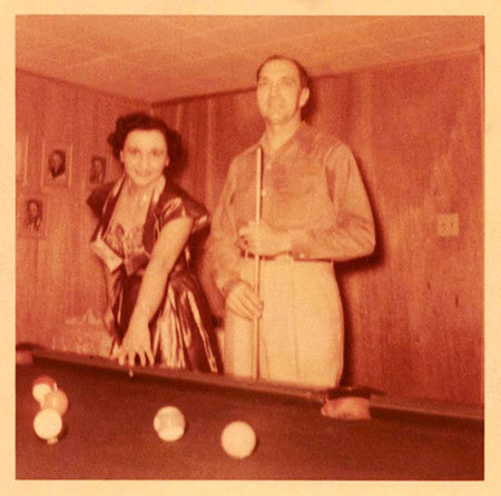 Christine and Freer playing pool at their home.