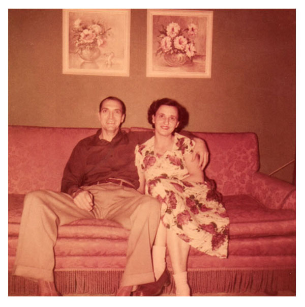 Freer and Christine sitting on red sofa 1951